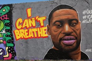 """George Floyd mural in Berlin. """"I Can't Breathe"""" is painted in bold yellow letters."""